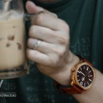 "Model having a ""Teh Si Peng"" (a national drink of Singapore's 'kopitiam') modeling a Bronze Diver"